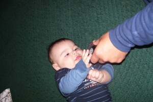 Playing with Daddy's finger